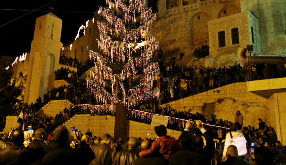 Visitors attend light-up of 35m Christmas tree at 1,500-year-old Saidnaya monastery, near Damascus