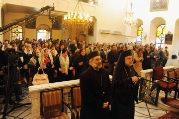 Armenian Orthodox Christians gather at their church of St Sarkis in Old Damascus for Christmas service in this handout photograph released by Syria's national news agency SANA